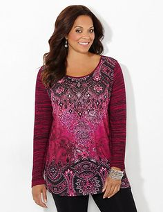 Our striking tunic features a variety of intricate scroll prints on the front with a coordinating space-dye print along the long sleeves and back. Studs scatter across the neckline for a shimmering finish. Scoop neckline. Long sleeves. Side slits at hem. Catherines tops are designed for the plus size woman to guarantee a flattering fit. catherines.com
