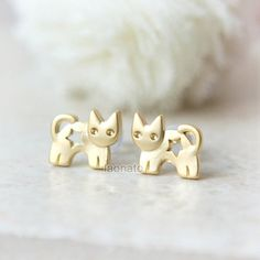 ★★Description★★    So cute kitty earrings. This listing is for one pair earrings.  Size: the cat measures approx. 10 x 8 mm ***use of surgical steel