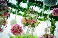 Pink and green birdcages with pearls and floral balls