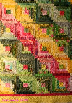 Pretty log cabin by Anne; Quilting by Vicki Welsh