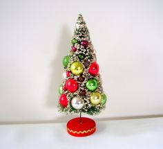 Vintage 50's Bottle Brush Christmas Tree with Mercury Glass Ornaments. $44.00, via Etsy.