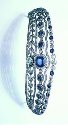 A belle époque sapphire and diamond tiara, of kokoshnik inspiration, millegrain-set with cushion-shaped sapphires & old brilliant, single & rose-cut diamonds, with a large old brilliant-cut diamond at the centre,  principal diamond approximately 2.80 carats.