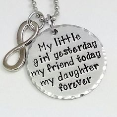 "Handstamped My Daughter, My friend... the bittersweet moment you realized that little girl is all grown up. INCLUDES: 1.25"" 14 gauge 1100 food grade aluminum round pendant stamped with the quote in picture. infinity charm CHAIN OPTIONS:18' Sterling SIlver20"" Sterling Silver18"" Stainless Steel20"" Stainless Steel22"" Stainless Steel24"" Ball Chain NO Chain key chain PACKAGING: Each item is packed in an organza drawstring bag. Additional bags are available for purchase if needed. I HIGHLY…"