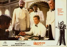 Gobinda is Khan's henchman. This is the scene where he crushes the dice Bond uses to beat Khan at backgammon.