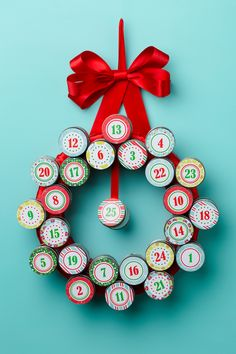 Looking for a modern advent calendar idea? This advent wreath craft is a creativ. : Looking for a modern advent calendar idea? This advent wreath craft is a creative twist on the traditional advent calendar. Read on for our free printable. Homemade Advent Calendars, Advent Calendars For Kids, Diy Advent Calendar, Kids Calendar, Calendar Ideas, Christmas Crafts For Kids, Holiday Crafts, Christmas Diy, Christmas Countdown