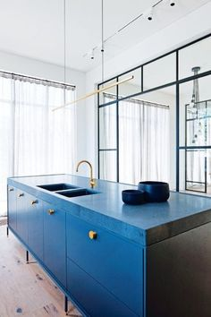House tour: the revival of a Victorian era home in Melbourne's Prahran: In the kitchen, basalt benchtop from Artedomus; tapware from Brodware; cabinet handles from B&B in Sweden; Archier 'Highline' pendant; oak flooring from Mafi Timbers.