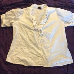 I just added this to my closet on Poshmark: Torrid button down ruffled blouse. Price: $9 Size: 1X