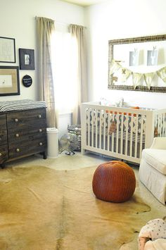 I like the large frame above the crib with bunting, etc.  Instead of committing to a wall paper, placing a printed fabric or contact paper inside a frame might be a good idea too.