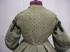 "1860's Printed Wool Civil War Era Daytime Ensemble | eBay svpmeow1; bust: 32""; waist: 27: skirt waist: 24""; skirt length: 38""; hem width: 150""; seller believes there was a waistband on bodice at one time, lining is sturdy, but some underarm staining & hold under one arm, bodice - wear, spots, tears to black silk, hole under 1 arm, repair on the waist, wear & stains on skirt, skirt lining tears"