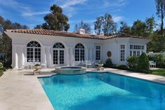 Mediterranean Swimming Pool with Gate, exterior stone floors, Fence, Arched window, Pool with hot tub, Transom window