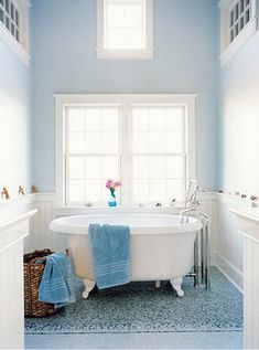 Love the soft baby blue and white color palette of this vintage-styled, feminine bathroom.
