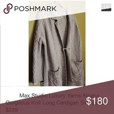 """Max Studio Alpaca Cardigan! This is a gorgeous, luxurious long knit sweater by Max Studio. Perfect for the upcoming fall!  » This sweater has two front pockets   » Variety of knit patterns in a soft cream color alpaca-nylon blend.  » Very cozy sweater in great condition.  » This sweater is a size medium, yet can fit a wide range of sizes thanks to the open, relaxed nature and fit.  » The sleeves fall to just above my wrist, a 3/4 look. However if you are shorter than 5' 9"""" I'm sure they will…"""
