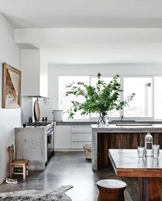 A beautiful relaxed family home on Victoria's gorgeous surf coast … featuring lots of concrete, on floors and counters in the kitchen and living areas, lots of fresh white on walls & ceilings and worn
