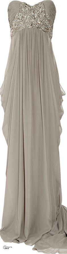 Harry and I are back from the play. Left a limo for Richard and Tom, so we could come back and dress. Marchesa ● Silk-crepe strapless gown.