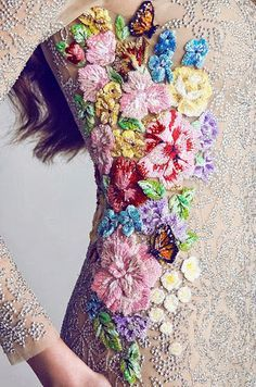 The handwork on this beautifully embroidered dress makes me linger just to take it in. (embroidery)