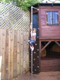 Fire pole and rock climbing wall extends onto fence