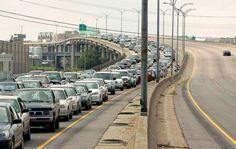 Cars carrying residents leave downtown New Orleans ahead of Hurricane Katrina in this August 28, 2005 file photo. (REUTERS/Rick Wilking)