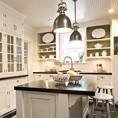 What has the same flexability and style of a little black dress in the world of home decor???  The answer…a White Kitchen! Yes…the white kitchen is something that you can dress up or down…a room that can reflect your mood with a simple change of curtains…accessories and by adding a pop of color. I thought …