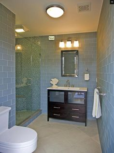large floor tiles set on diagonal, mixed with large subway tiles on wall.  Makes bathroom look much larger.