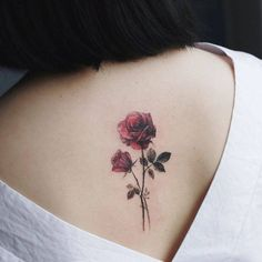 Red rose tattoo on the upper back.