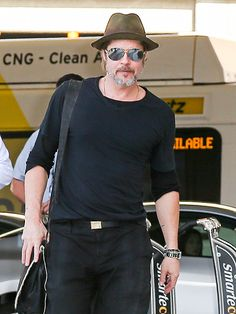 We just love Brad Pitt's salt 'n' pepper beard, not to mention his chic aviators with silver flash lenses!