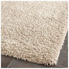 The one-inch pile height gives this plush beige shag rug both comfort and luxurious style. The neutral beige color makes it perfect for any room in the house. This casual style rug measures x and is perfect for any small living area. Thing 1, Vintage Trends, Square, My Living Room, Tent Living, Small Living, Living Area, Beige Color, Online Home Decor Stores