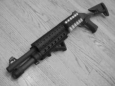 Benelli M4 Super 90  12 gauge semi-automatic shotgun B&T quad railed hand guard  Mesa Tactical shell holder