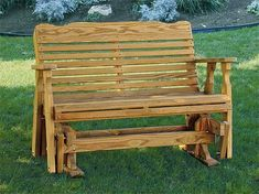 The Amish Pine Wood Westchester Glider from DutchCrafters Amish Furniture is made for relaxing in outdoor spaces like the patio or porch. Made to order in the Unites States in your choice of 3 lengths, with water sealer already applied, and up to 2 cupholders. #glider #outdoor #wooden #porch