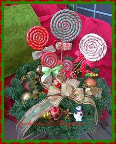DIY Christmas Lollipop Ornaments-This Gal makes it look SOO easy.  I'm definitely going to make these.