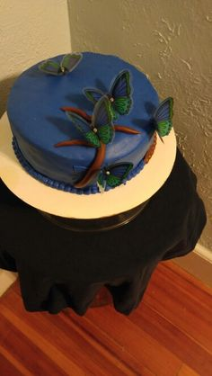 Coconut sponge cake covered with fondant decorated with blue butterflies