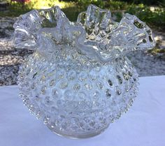Vintage Fenton Glass hobnail vase with rare clear or crystal treatment. Only made from 1968 till 1969. Measures 6 1/4 inches across the