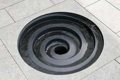 Water feature: The design speaks to the eternal and recurring characteristics of water in nature. Listen to the swirling and rippling sounds as the water courses through this man made eddy. No, I do not see it as a drain!