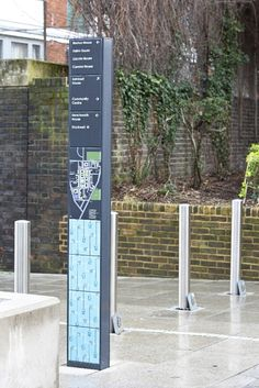 Hat-Trick Design has created a tile-based wayfinding system for the Stockwell Park Estate Development in south London in a bid to make it 'more accessible and welcoming'. Directional Signage, Wayfinding Signs, Outdoor Signage, Pylon Signage, Environmental Graphic Design, Environmental Graphics, Lanscape Design, Exterior Signage, Signage Design