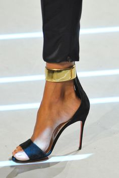 :: Christian Louboutin on the runway SS 2013 :: Black and Gold shoes