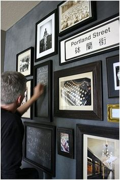 chalkboard wall with photos and empty frames to write in!!! Absolutely love it. One wall in basement.