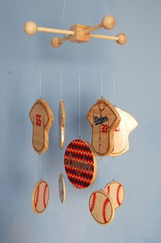 Wooden baby mobile for a baseball themed nursery. Choose your team!