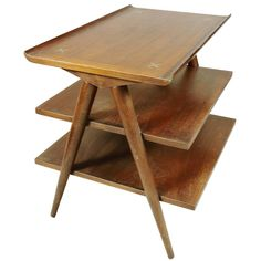 Mid-Century Modern American of Martinsville Walnut Magazine Table | From a unique collection of antique and modern end tables at https://www.1stdibs.com/furniture/tables/end-tables/