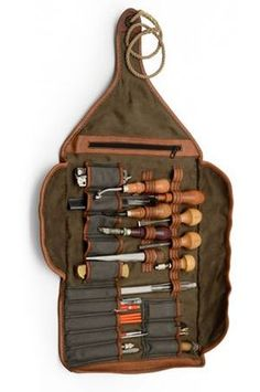 Leather roll-up containing leatherworking tools.
