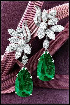 Alternate view: Harry Winston emerald and diamond earrings with 14 carats of diamonds and two emeralds weighing 16.57 and 14.58 carats. Via Diamonds in the Library.