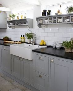 Really like this old style kitchen......the grey cupboard doors speak to me