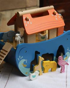 Noahs Ark Shape Sorter - Painted wooden shape sorter with 7 pairs of animals, slide, outside door, removable roof panels and carry handle, Noah and his wife that can also be shape sorted. Size wide x deep x high Shape Sort, Wooden Shapes, Roof Panels, Ark, Kids Toys, Handle, Deep, Children, Animals