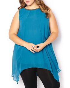 Sleeveless Layered Blouse | Penningtons | This flowing and feminine plus-size blouse will add a sophisticated touch to your winter wardrobe. Made with a light and fluid fabric, it features an embellished neckline, tie at back an asymmetric hemline. Team it with fitted dark jeans and heels for a night out!  #Penningtons