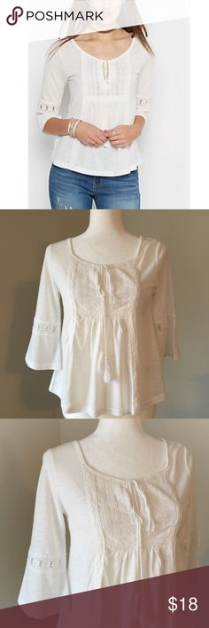 """embroidered white peasant top Beautiful peasant blouse with a crochet embroidered design on the chest and elbow. Fabric is 91% polyester and 9% rayon.  My mannequin's measurements: * size 6 in waist (26"""" inches) * 36"""" inch bust line  * 36"""" inches around hips Rue21 Tops Blouses"""