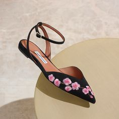 TALKING PIECES. Tabitha Simmons linen flat Vera Blossom skimmer in black and pink $850.