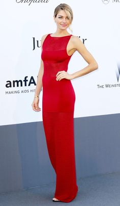 Model Jessica Hart in a sleek red body-con column dress