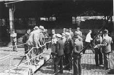 """Belgian officials at the gangplank of the """"St. Louis"""" after the ship was forced to return to Europe from Cuba. Belgium granted entry to some of the passengers. Antwerp, Belgium, June 1939. ~ US Holocaust Memorial Museum"""