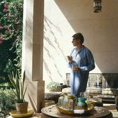 Yves Saint Laurent in his garden in Marrakech in a 1980 issue of Vogue.