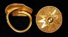 PAIR OF SCYTHIAN OR WESTERN ASIATIC GOLD HAIR ORNAMENTS, VII cent. B.C. Each composed of convex round sheet with beaded wire perimeter, granulated triangles forming central ten-pointed star in one ornament and eleven-pointed star in other one. At the center there is a half-sphere boss bordered by beaded wire and small triangles of granulation. A solid thick wire spiral soldered to the center of the back. 22 x 21 x 24.