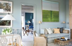 Sofa, SFI, in Summer Hill fabric. Armchairs, Country House Antiques. Chair, SFI, in Keleen Leathers. Floor lamps, Munder-Skiles. Ceiling fixture, Ingo Maurer. Coffee table, Williams-Sonoma Home. Rug, Sacco Carpet. Painting, John Saladino. Max Kim-Bee  - Veranda.com