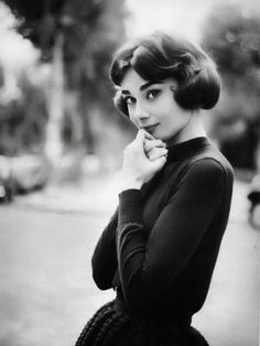 """Audrey Hepburn photographed by Marc Shaw in Paris (France), during a break in the filming of """"Love in the Afternoon"""", in November 1956."""